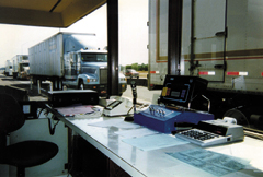 Photograph of a truck weigh station.