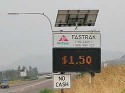 "Picture showing ""FastTrak"" toll of $1.50, and indicating a ""no cash"" (i.e., all electronic) collection method."