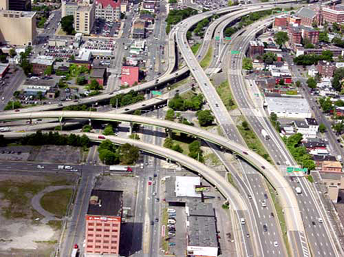 Aerial P O Of A Freeway To Freeway Interchange In An Urban Setting Showing