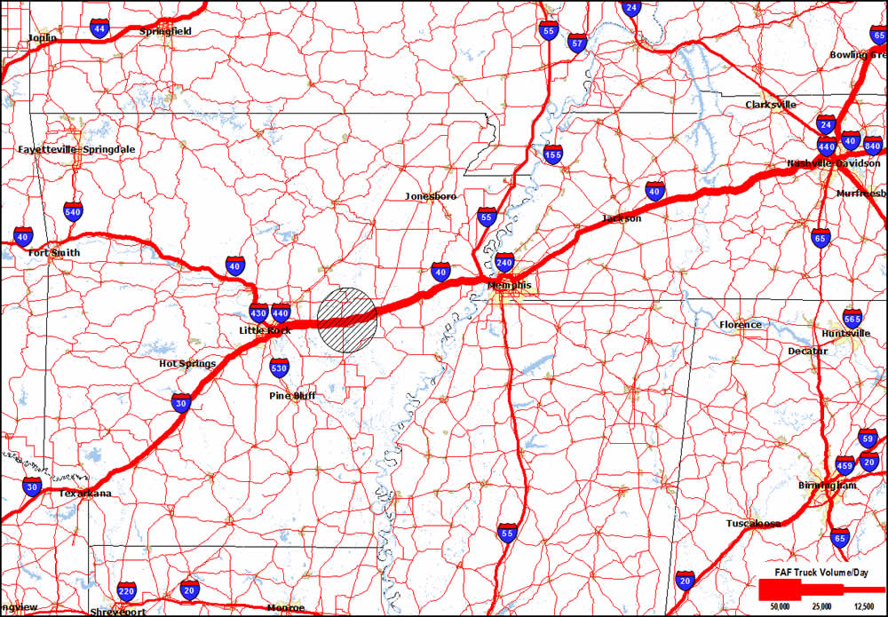 A regional map of Arkansas and western Tennessee showing major concentration of truck volumes on I-40. A shaded circle between Little Rock, AR and Memphis, TN identifies the segment of I-40 affected by flooding.