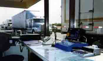 Trucks entering weigh station for weight compliance check