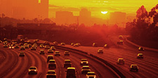 Vehicles on Interstate Highway at Sunset