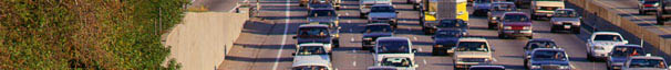 photo of traffic traveling in both directions on a congested highway